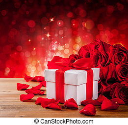 Valentines gift box on abstract red background - Valentines...