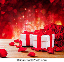 Valentines gift boxes on abstract red background -...