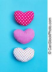 Valentine's hearts on blue background.