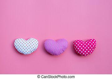 Valentine's hearts on pink background.