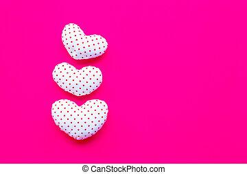 Valentine's hearts on pink background