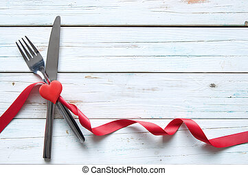 Valentines meal - Menu background with silk red ribbon tied...