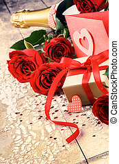 Valentine's setting with present and red roses