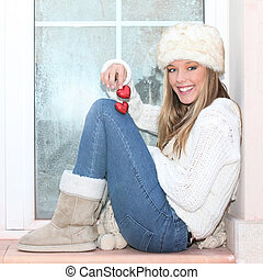 Valentines winter girl with two red hearts