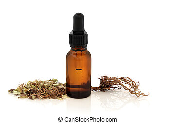 Valerian herb root and apothecary dropper bottle, over white background with reflection. Modern day alternative equivalent to valium acting as a tranquilizer.