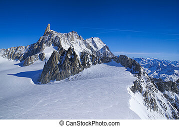 Breathtaking view of snowy mountains from the top in Valle Blanche