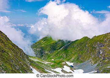 valley of Fagaras mountains in clouds. beautiful summer...