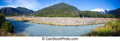 Cauquenes River bank and view of mountain (volcano) Tronador and glacier on sunny day. Andes, Patagonia, Argentina