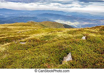 valley on hillside of mountain range - mountain landscape....