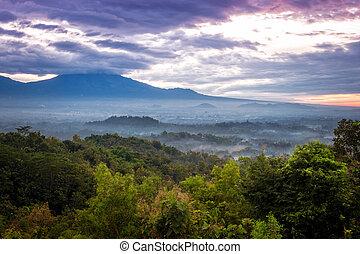 Valley sunrise over Borobudur