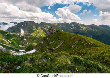 valley with snow in summer mountains. gorgeous mountainous...