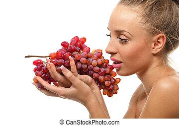 valor en cartera de mujer, un, ramo, uvas rojas