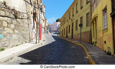 VALPARAISO, CHILE - OCTOBER 11, 2019: View of the streets in the historical center of the city at summer time. Valparaiso. Chile.