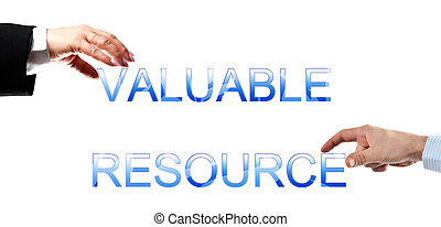 Valuable resource words made by business woman and man hands