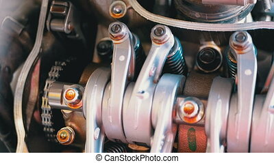 Valves and Valve Mechanisms in Motorcycle Engine. Camshaft...