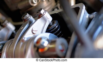 Valves in Motorcycle Engine. Camshaft motorcycle engine....