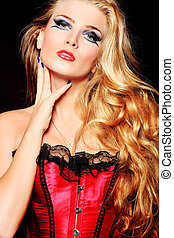 vamp woman - Portrait of a beautiful blonde woman over black...