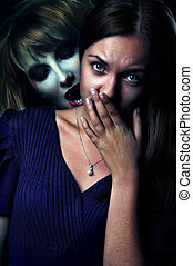 scary vampire biting a frightened girl at night