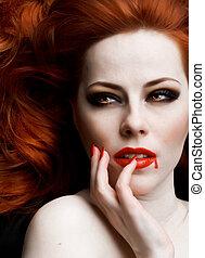 Vampire - Closeup portrait of beautiful redhead vampire...