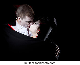 vampire couple kiss - a vampire couple holding each other...