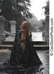 Vampire, Dark beauty under rain, red hair woman with long black coat