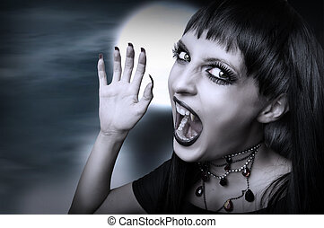 Vampire gothic style for halloween. Portrait of screaming young brunette woman with fangs