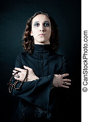 Vampire in black - gothic men in black soutane isolated on...