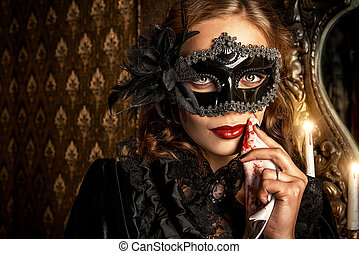 vampire in mask - Charming mysterious girl in black mask and...