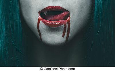 Vampire lips in blood close-up - Sensual female vampire lips...