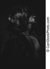 vampire man with great contrasts of light, large black cloak