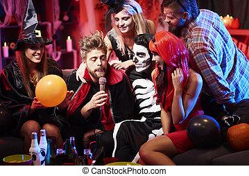 Vampire singing at halloween party