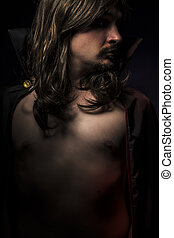 Vampire with black coat and long hair, nude