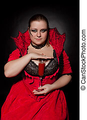 Vampire with glass full of blood