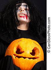 Vampire with pumpkin