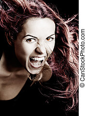 Vampire woman - Studio portrait of a woman with a vampire...
