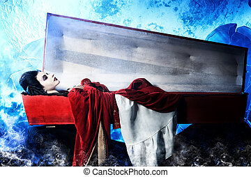 vampire woman - Bloodthirsty vampire woman lies in a coffin...