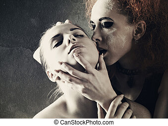 Vampire's kiss. Fantasy female portrait against dark grungy backgrounds
