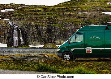 Van at lake waterfall Flotvatnet Norway