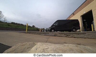 van drives to the warehouse for loading.