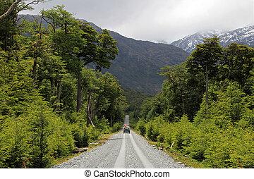 Van driving on Carretera Austral, Chile - Van driving on...