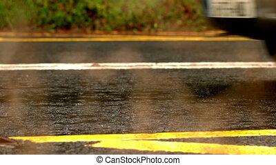 Van driving over wet road in slow motion