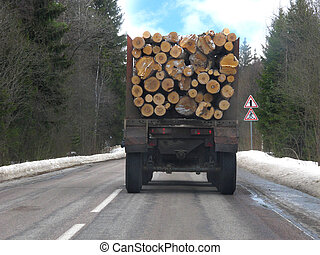 van with firewood under the white background