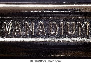 Written word on metal, part of industrial tool.