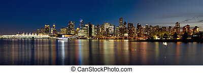 Vancouver BC Canada Skyline along False Creek from Stanley Park at Blue Hour Panorama