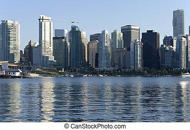 Vancouver BC skyline. - Vancouver BC skyline and tourist...