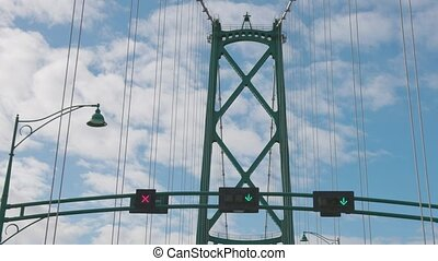 Slow Motion drive across the famous Lions Gate Bridge in the modern Downtown City. Sunny Spring Day.