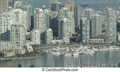 Vancouver condos. - View of condos and marina in downtown...