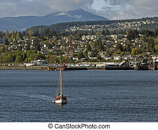 Vancouver Island and Nanaimo - Sea with boat and city in the...
