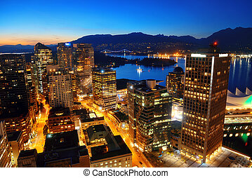 Vancouver rooftop view with urban architectures at dusk.