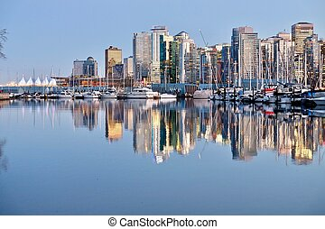 Vancouver Skyline and reflection in calm water.